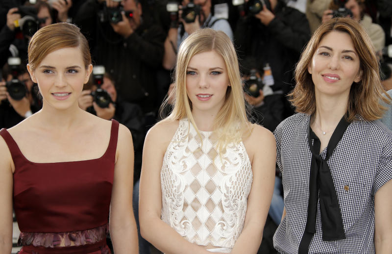 From left, actors Emma Watson, Claire Julien and director Sofia Coppola pose for photographers during a photo call for the film The Bling Ring at the 66th international film festival, in Cannes, southern France, Thursday, May 16, 2013. (AP Photo/Francois Mori)