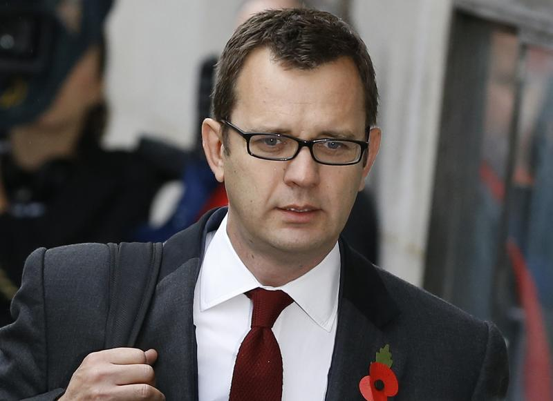Andy Coulson arrives at The Old Bailey law court in London, Thursday, Oct. 31, 2013. Former News of the World national newspaper editors Rebekah Brooks and Andy Coulson went on trial Monday, along with several others, on charges relating to the hacking of phones and bribing officials while they were employed at the now closed tabloid paper. (AP Photo/Kirsty Wigglesworth)
