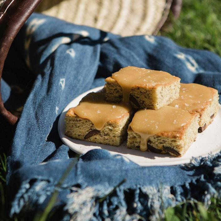 """<p>Leave a few banana bread bars in the fridge without icing for the perfect Monday morning breakfast. You won't regret it. </p><p><em><a href=""""https://www.womansday.com/food-recipes/a32884263/banana-bread-bars-with-salted-toffee-icing-recipe/"""" rel=""""nofollow noopener"""" target=""""_blank"""" data-ylk=""""slk:Get the Banana Bread Bars with Salted-Toffee Icing recipe."""" class=""""link rapid-noclick-resp"""">Get the Banana Bread Bars with Salted-Toffee Icing recipe.</a></em></p>"""