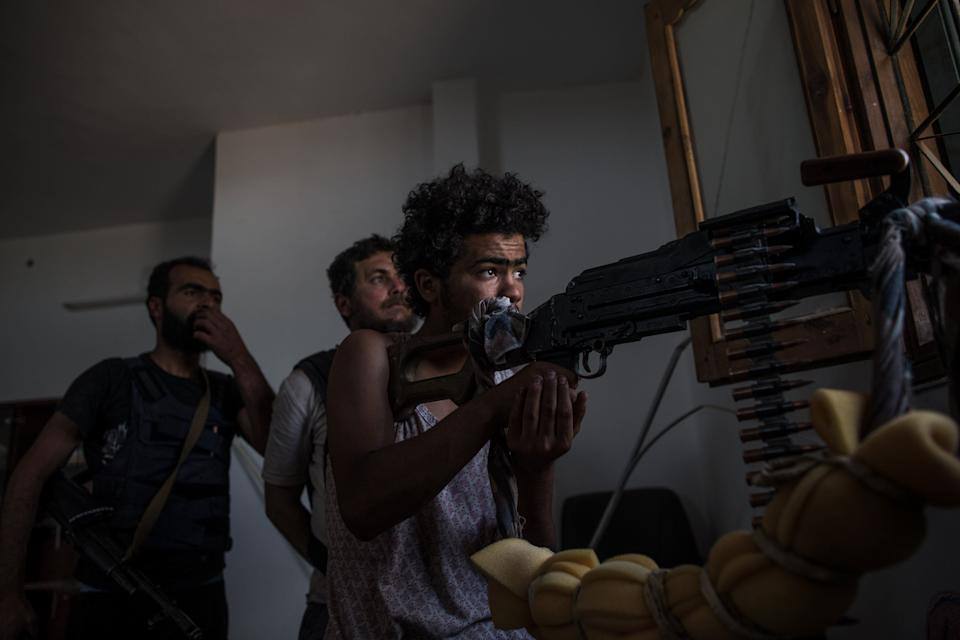 Libyan National Accord Government troops clash military commander Khalifa Haftar's troops on course of the airport in Al Sawani region of Tripoli, Libya on May 15, 2019. (Photo: Amru Salahuddien/Anadolu Agency/Getty Images)