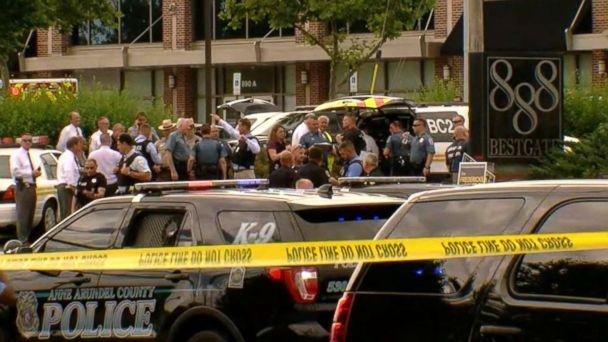 PHOTO: Officials and first responders gather outside an office building at 888 Bestgate Road in Annapolis, Md., after reports of a shooting in the offices of the Capital Gazette newspaper, June 28, 2018. (WJLA)