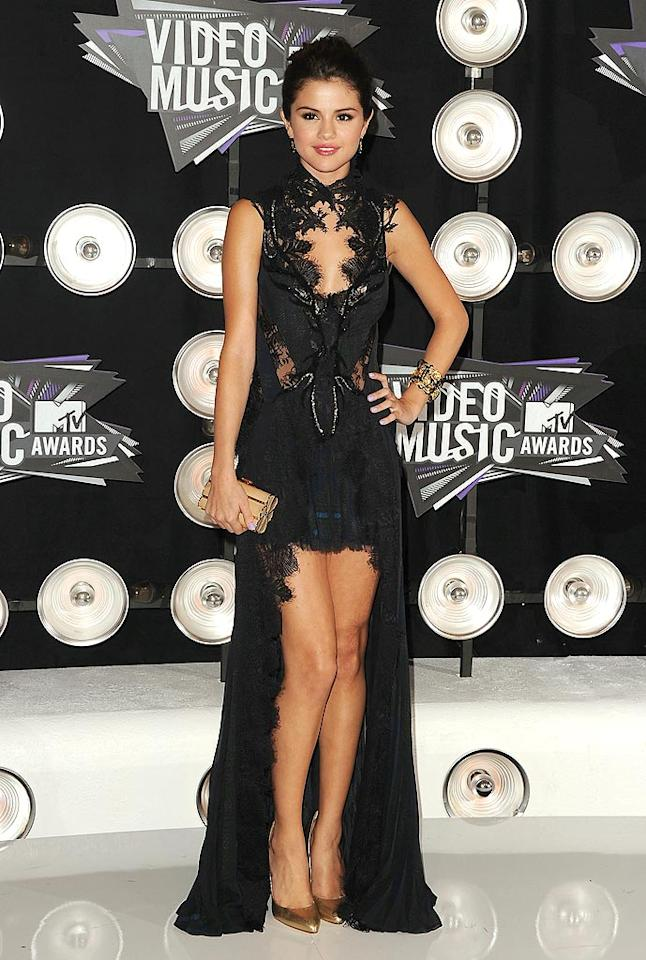 "Selena Gomez arrived at the 2011 MTV VMAs -- held at the Nokia Theatre in Los Angeles -- wearing a dramatic Julien MacDonald gown, which she paired with gold Brian Atwood heels and a Judith Leiber clutch. Is it us, or does the 19-year-old look like Elvira's little sister in this vampy, goth ensemble? Jason Merritt/<a href=""http://www.gettyimages.com/"" target=""new"">GettyImages.com</a> - August 28, 2011"