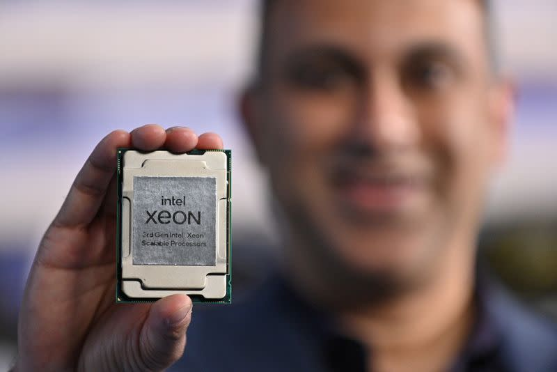 """Handout photo of Navin Shenoy, executive vice president and general manager of the data platforms group at Intel Corp, holding one of the company's """"Ice Lake"""" data center chips"""