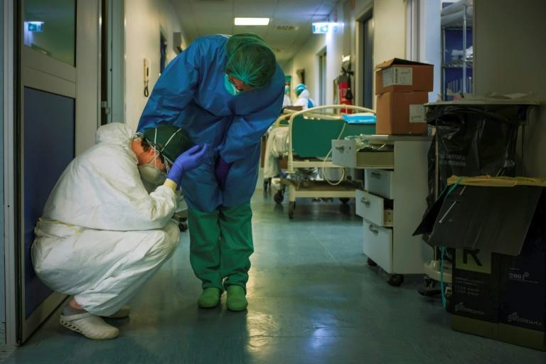 Most of the deaths in Italy are still in the north, whose world-class health care system is under tremendous strain (AFP Photo/Paolo MIRANDA)