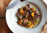 "A rich stew brought to life with butternut squash and warming spices like cardamom and clove. <a href=""https://www.bonappetit.com/recipe/braised-lamb-with-roasted-squash-and-onion-sauce?mbid=synd_yahoo_rss"" rel=""nofollow noopener"" target=""_blank"" data-ylk=""slk:See recipe."" class=""link rapid-noclick-resp"">See recipe.</a>"