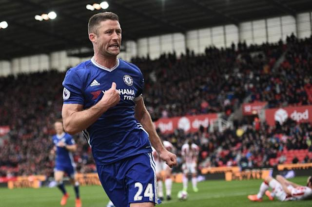 Chelsea's defender Gary Cahill (C) celebrates after scoring on March 18, 2017 (AFP Photo/Oli SCARFF )