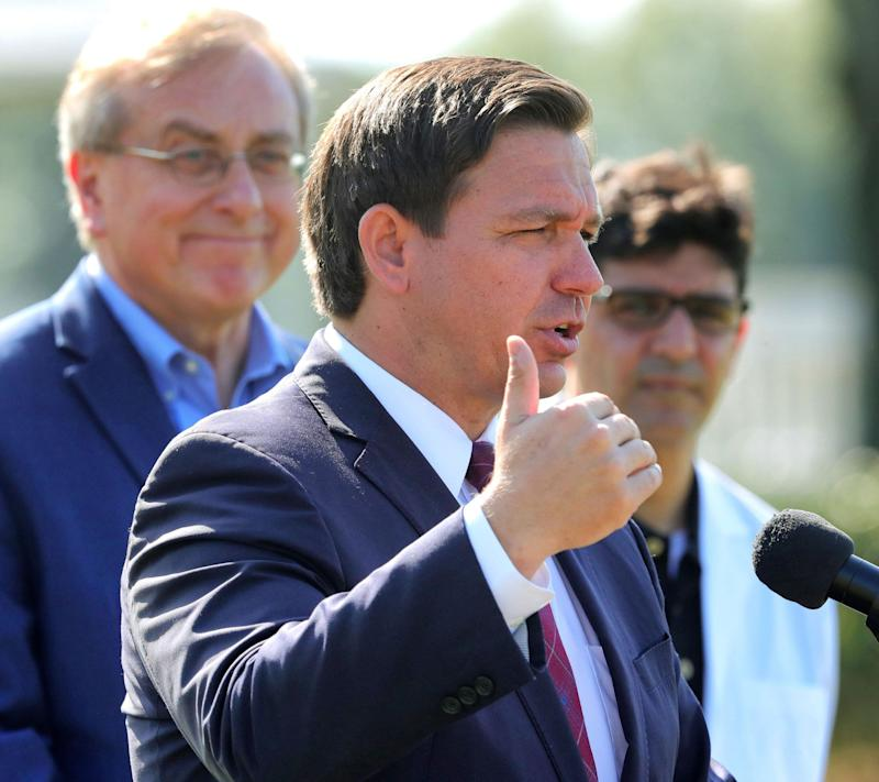 Gov. Ron DeSantis (R) has spurned calls for a statewide stay-at-home order, saying the cost would be too high and that parts of the state don't need it. (Photo: Orlando Sentinel via Getty Images)