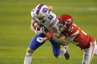 Buffalo Bills wide receiver Cole Beasley (11) is tackled by Kansas City Chiefs cornerback Bashaud Breeland (21) after catching a pass during the second half of the AFC championship NFL football game, Sunday, Jan. 24, 2021, in Kansas City, Mo. (AP Photo/Charlie Riedel)
