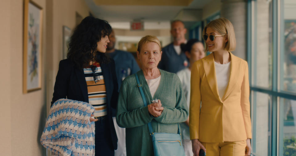 """This image released by Netflix shows, from left, Eiza Gonzalez, Dianne Wiest and Rosamund Pike in a scene from """"I Care A Lot."""" Pike was nominated for a Golden Globe for best actress in a motion picture musical or comedy. (Seacia Pavao/Netflix via AP)"""