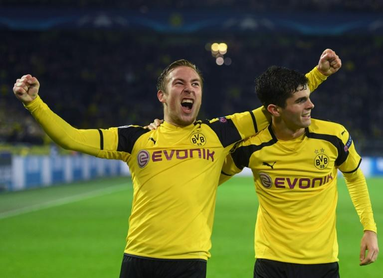 Dortmund's young guns (from L) Felix Passlack, 18, and Christian Pulisic, 19, celebrate scoring a goal during their Champions League match against Legia Warszawa, in Dortmund, in November 2016