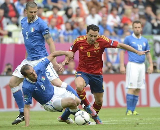 Spanish midfielder Xavi Hernandez (R) vies with Italian defender Giorgio Chiellini during the Euro 2012 championships football match Spain vs Italy on June 10, 2012 at the Gdansk Arena. AFP PHOTO / PIERRE-PHILIPPE MARCOUPIERRE-PHILIPPE MARCOU/AFP/GettyImages