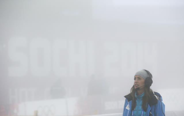 A broadcast staffer stands in thick fog at Laura Biathlon centre at the 2014 Winter Olympics, Monday, Feb. 17, 2014, in Krasnaya Polyana, Russia. The men's 15-kilometer mass-start biathlon race at the Sochi Olympics has been delayed due to fog, one day after the event had been called off for the same reason. (AP Photo/Lee Jin-man)