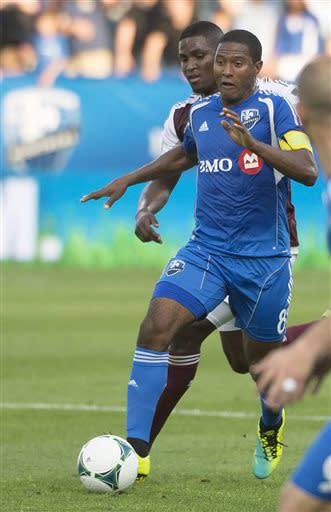 Montreal Impact's Patrice Bernier brings the ball forward during the first half of an MLS soccer game against Colorado Rapids in Montreal on Saturday, June 29, 2013. (AP Photo/The Canadian Press, Peter McCabe)