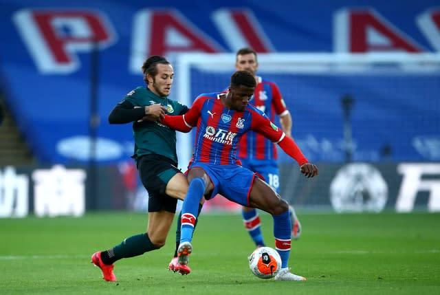 Josh Brownhill, left, and Crystal Palace's Wilfried Zaha battle for the ball (Hannah McKay/NMC Pool/PA)