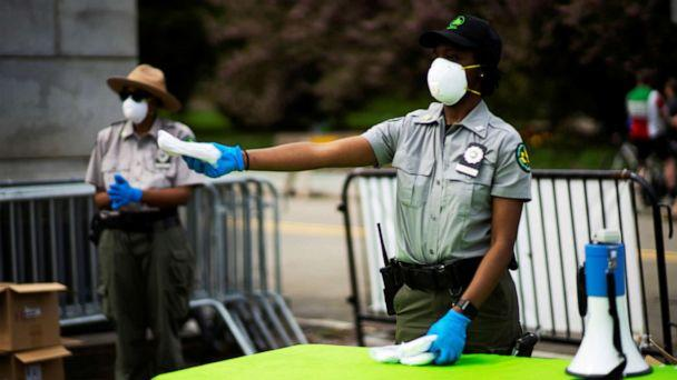 PHOTO: Park Rangers distribute free masks to people at Grand Army Plaza, during the outbreak of coronavirus in the Brooklyn, New York. (Eduardo Munoz/Reuters)