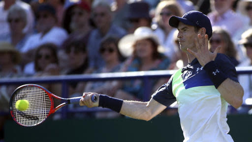 Britain's Andy Murray returns the ball to Switzerland's Stan Wawrinka on day two of the Nature Valley International at Devonshire Park, Eastbourne, south England, Monday June 25, 2018. (Steven Paston/PA via AP)