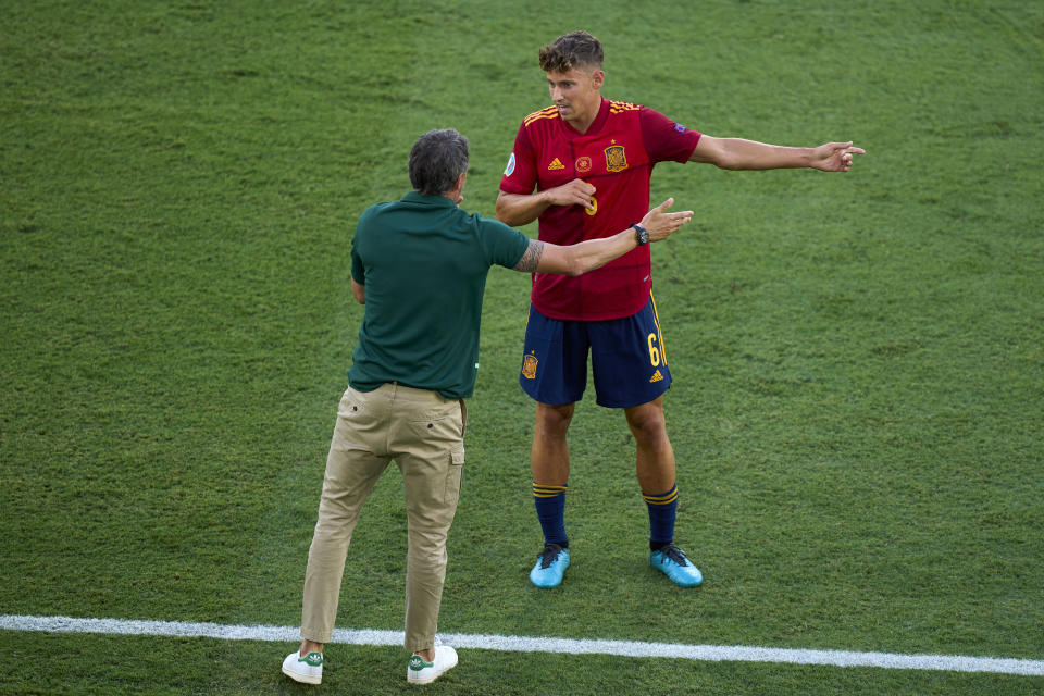 SEVILLE, SPAIN - JUNE 19: Luis Enrique, Manager and Marcos Llorente of Spain speaking during the UEFA Euro 2020 Championship Group E match between Spain and Poland at Estadio La Cartuja on June 19, 2021 in Seville, Spain. (Photo by Diego Souto/Quality Sport Images/Getty Images)