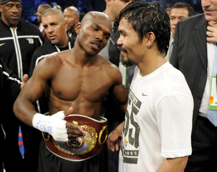 Timothy Bradley, from Palm Springs, Calif., left, talks with Manny Pacquiao, from the Philippines, following their WBO welterweight title fight Saturday, June 9, 2012, in Las Vegas. Bradley won the fight by split decision. (AP Photo/Chris Carlson)