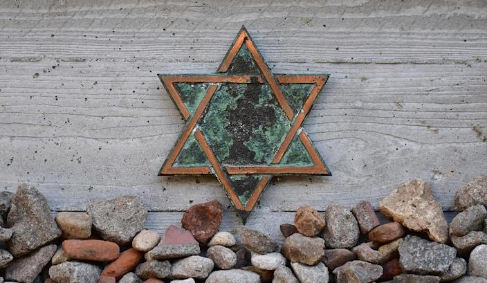 The six-pointed Star of David is a symbol of Jewish identity and Judaism (AFP Photo/Tobias SCHWARZ)