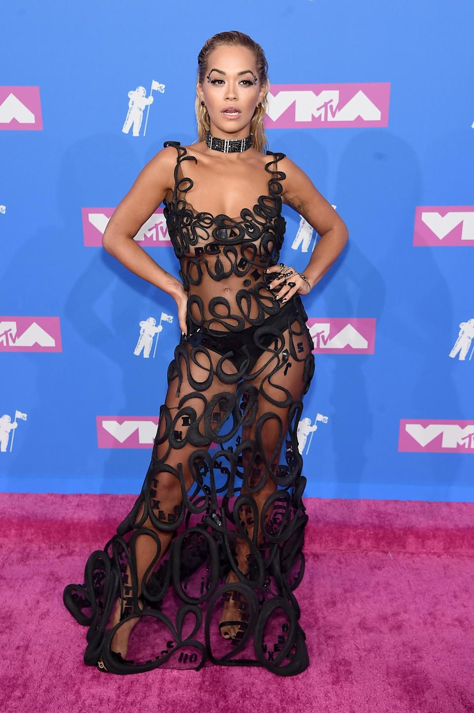 <p>Rita Ora also dabbled in the sheer trend this year courtesy of a Fleur du Mal dress. The singer finished the showstopping ensemble with slicked-back hair and a noughties-style choker. <em>[Photo: Getty]</em> </p>