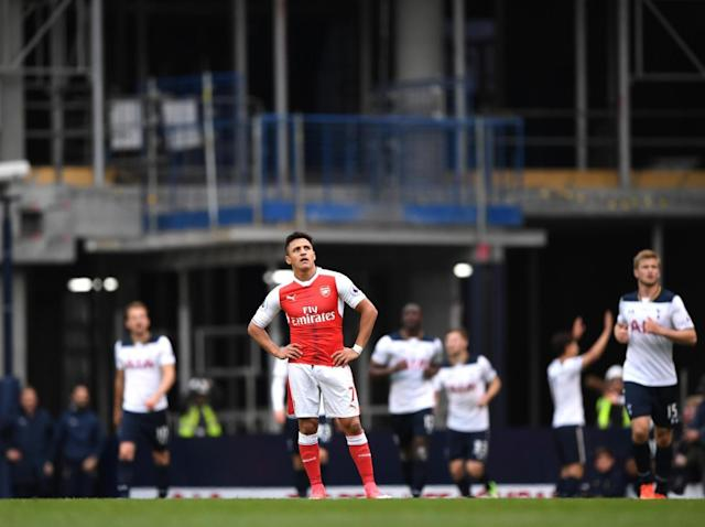 Sanchez stands dejected as Spurs celebrate their second (Getty)