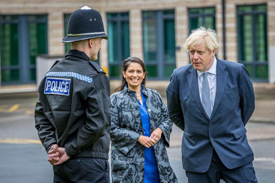 NORTHALLERTON, ENGLAND - JULY 30: Prime Minster, Boris Johnson and Home Secretary, Priti Patel visit The North Yorkshire police and are introduced to recently graduated Police Officers on July 30, 2020 in Northallerton, North Yorkshire, England. (Photo by Charlotte Graham - WPA Pool/Getty)