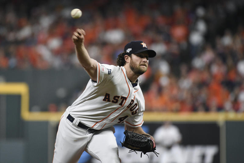 FILE - In this Oct. 5, 2019 file photo, Houston Astros starting pitcher Gerrit Cole delivers to a Tampa Bay Rays batter during the first inning during Game 2 of a baseball American League Division Series in Houston. The  Astros and their heavyweight rotation have only one chance left to knock out the pesky Rays. It's up to Gerrit Cole in Game 5 on Oct. 10.  (AP Photo/Eric Christian Smith, File)