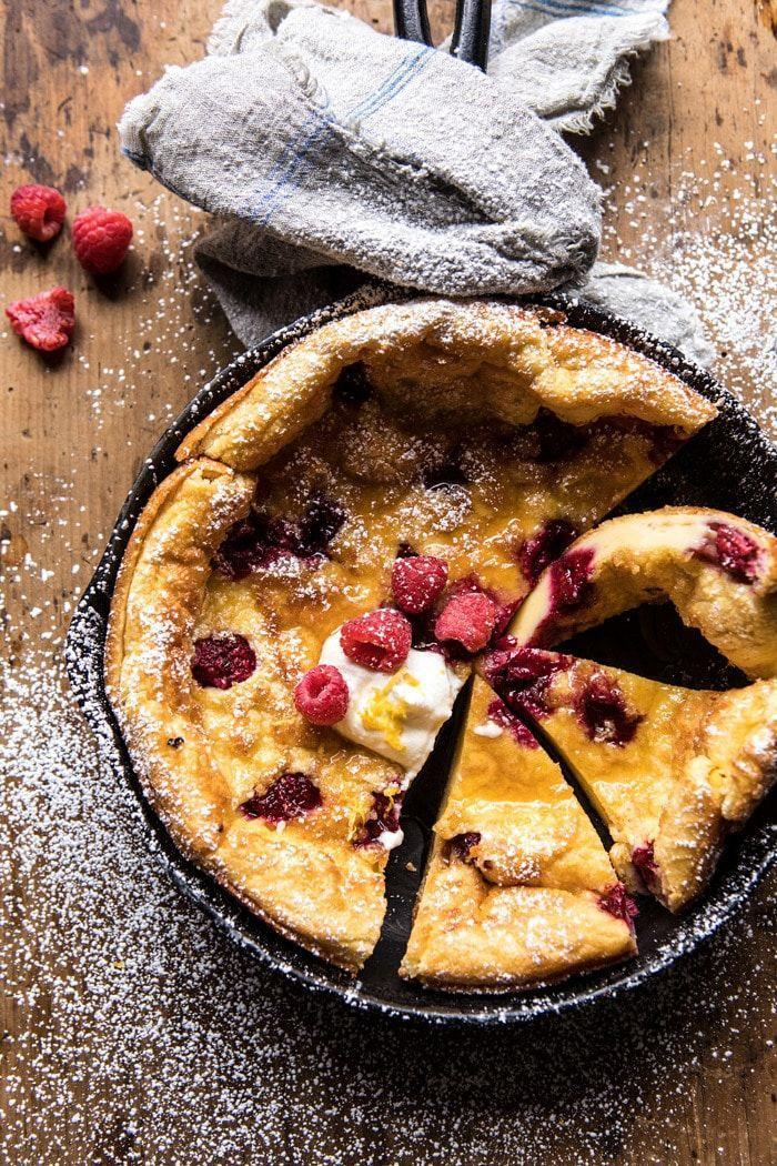 """<p>It's actually ridiculously easy to whip up this fruity pancake thanks to your trusty <a href=""""https://www.amazon.com/Lodge-Skillet-Pre-Seasoned-Skillet-Silicone/dp/B00G2XGC88?tag=syn-yahoo-20&ascsubtag=%5Bartid%7C10050.g.1681%5Bsrc%7Cyahoo-us"""" rel=""""nofollow noopener"""" target=""""_blank"""" data-ylk=""""slk:cast iron skillet"""" class=""""link rapid-noclick-resp"""">cast iron skillet</a>. </p><p><strong>Get the recipe at <a href=""""https://www.halfbakedharvest.com/raspberry-lemon-ricotta-dutch-baby/"""" rel=""""nofollow noopener"""" target=""""_blank"""" data-ylk=""""slk:Half Baked Harvest"""" class=""""link rapid-noclick-resp"""">Half Baked Harvest</a>.</strong></p><p><a class=""""link rapid-noclick-resp"""" href=""""https://www.amazon.com/Victoria-Skillet-Seasoned-Flaxseed-Certified/dp/B01726HD72/?tag=syn-yahoo-20&ascsubtag=%5Bartid%7C10050.g.1681%5Bsrc%7Cyahoo-us"""" rel=""""nofollow noopener"""" target=""""_blank"""" data-ylk=""""slk:SHOP CAST IRON SKILLETS"""">SHOP CAST IRON SKILLETS</a></p>"""