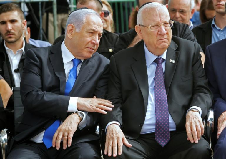 Netanyahu sitting next to President Reuven Rivlin on Thursday -- the latter will on Sunday meet party heads as a prelude to mandating one to attempt to form a coalition government (AFP Photo/GIL COHEN-MAGEN)