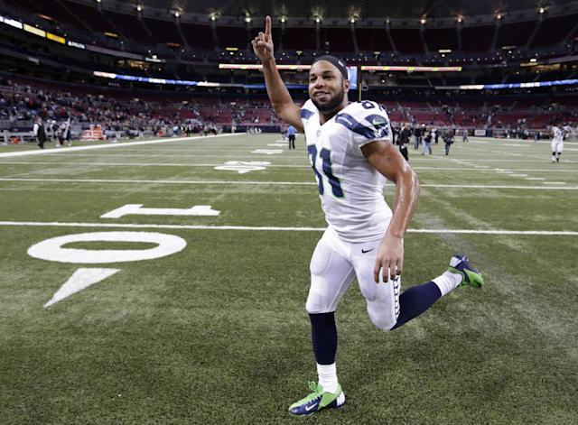 Seattle Seahawks wide receiver Golden Tate (81) celebrates after an NFL football game against the St. Louis Rams, Monday, Oct. 28, 2013, in St. Louis. The Seahawks won 14-9. (AP Photo/Michael Conroy)