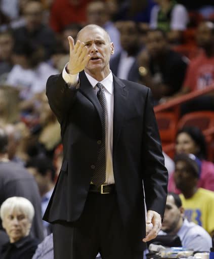 Dallas Mavericks head coach Rick Carlisle calls out to players during the first half of an NBA basketball game against the Miami Heat, Friday, Nov. 15, 2013, in Miami. (AP Photo/Wilfredo Lee)