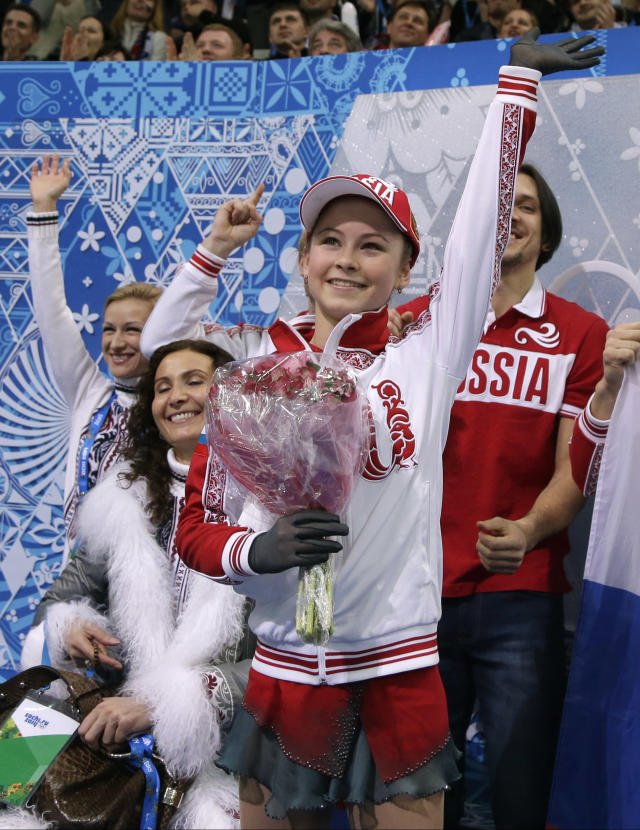 Julia Lipnitskaia of Russia gestures to spectators in the results area after competing in the women's team free skate figure skating competition at the Iceberg Skating Palace during the 2014 Winter Olympics, Sunday, Feb. 9, 2014, in Sochi, Russia. (AP Photo/Darron Cummings, Pool)