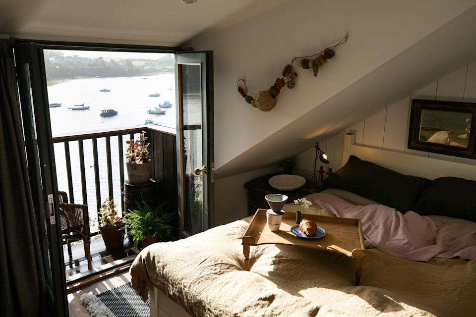 """<p>Did someone say 'boathouse with gin bar'? That's exactly what you're going to get with this adorable coastal retreat. </p><p>A quick look inside this boathouse and you'll find a window seat overlooking the bay and a wood burner – the perfect spot for lounging around on a Friday evening cuddled up with a glass of merlot. At the weekend, you could kayak your way to Kingbridge and Salcombe and head to a local café or take off on the coastal path for the afternoon. </p><p><strong>Boathouse for 2 from £175 per night</strong></p><p><a class=""""link rapid-noclick-resp"""" href=""""https://www.canopyandstars.co.uk/britain/england/devon/bowcombe-boathouse/bowcombe-boathouse"""" rel=""""nofollow noopener"""" target=""""_blank"""" data-ylk=""""slk:BOOK ONLINE"""">BOOK ONLINE</a></p>"""