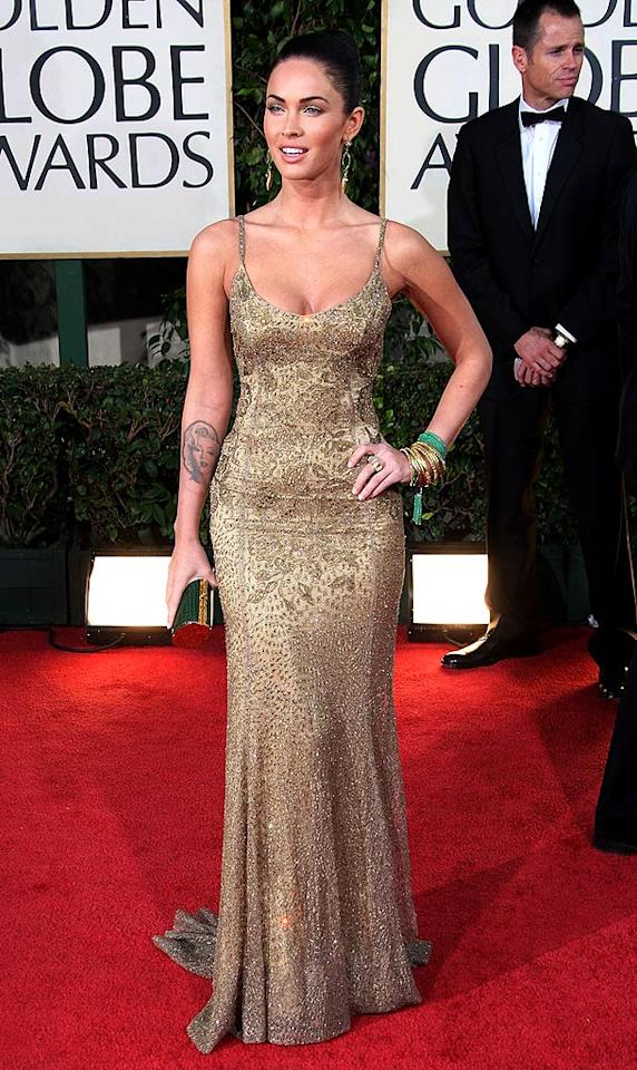 """Megan Fox was anything but foxy thanks to her tasteless tattoo and granny curtain of a dress, courtesy of Ralph Lauren. Frazer Harrison/<a href=""""http://www.gettyimages.com/"""" target=""""new"""">GettyImages.com</a> - January 11, 2009"""