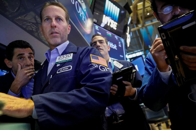Stocks, dollar rebound on upbeat data; yields rise