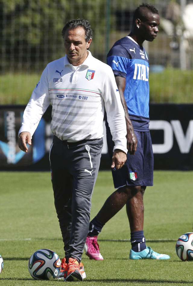 Italy's coach Cesare Prandelli, front, leads his team's training session as player Mario Balotelli walks behind in Mangaratiba, Brazil, Thursday, June 12, 2014. Italy plays in group D at the World Cup. (AP Photo/Antonio Calanni)