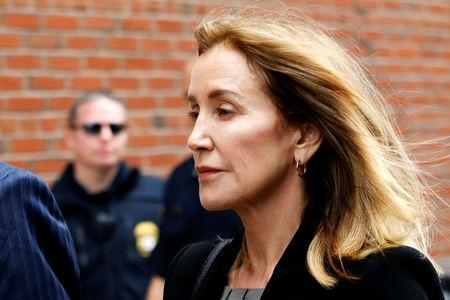 Actor Felicity Huffman arrives at the federal courthouse in Boston
