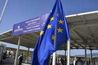 A view of the entrance of the new multi-purpose reception and identification migrant centre which was constructed near Vathy town, on the eastern Aegean island of Samos, Greece, Saturday, Sept. 18, 2021. The centre constructed following a 121 million euros agreement between the European Commission and the Greek Ministry of Migration and Asylum, an amount granted to Greece for the construction of 3 reception centres on the islands of Samos, Kos, and Leros. (AP Photo/Michael Svarnias)