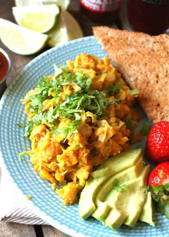 """Smashed chickpeas make for a surprisingly convincing egg substitute in this <a rel=""""nofollow"""" href=""""http://www.fettlevegan.com/recipes/mexican-chickpea-scramble"""">high-protein scramble</a>."""