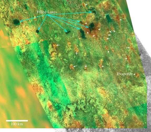 Cassini VIMS/RADAR hybrid image of filled and dry lakes south of Titan's methane sea Ligeia Mare. Blue arrows indicate current lakes, while the white arrows point to evaporates on dry lakes.