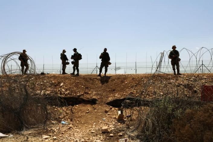 FILE PHOTO: Israeli soldiers guard along a fence leading to the Israeli-occupied West Bank, as part of search efforts to capture six Palestinian men who had escaped from Gilboa prison earlier this week, in northern Israel