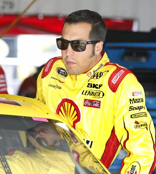 Sam Hornish Jr. climbs into his race car during practice for Sunday's NASCAR Sprint Cup Series Pennsylvania 400 auto race, Friday, Aug. 3, 2012, at Pocono Raceway in Long Pond, Pa. Hornish has replaced A.J. Allmendinger while NASCAR is still investigating Allmendinger's positive drug test. (AP Photo/Mel Evans)