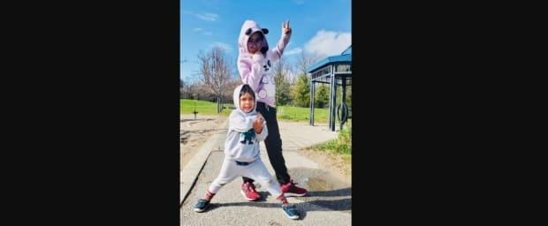 Anaya, 10, and Jax, 4, are pictured in this photo on the SickKids Foundation's fundraiser page. The siblings were playing in their driveway on Sunday when a black Mercedes went off the road, striking them and a neighbour.  (SickKids - image credit)