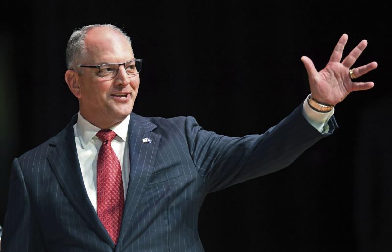 FILE - In this Sept. 19, 2019, file photo, Gov. John Bel Edwards acknowledges his supporters as he comes out onstage for a debate with Eddie Rispone and Republican Rep. Ralph Abraham in Baton Rouge, La. Edwards is battling to hold onto the Democrats' only governorship in the Deep South. (Bill Feig/The Advocate via AP, Pool, File)