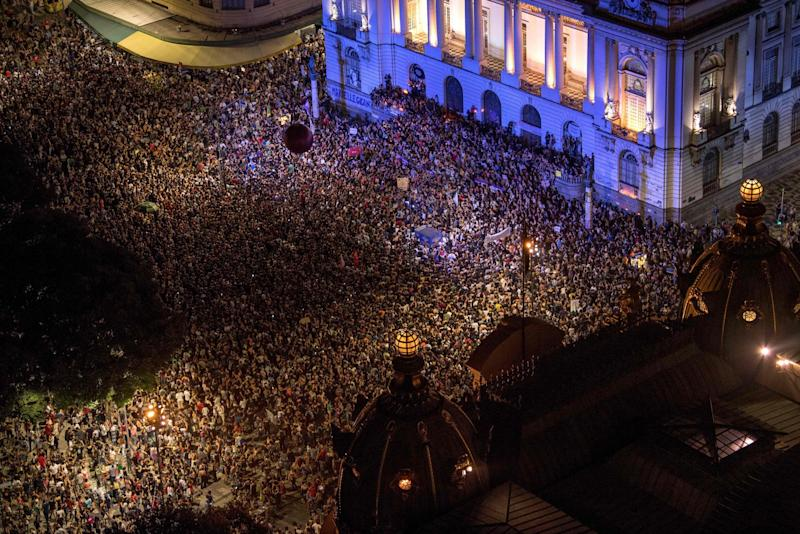 Brazilians gathered to mourn the popular councilwoman (AFP): AFP/Getty Images