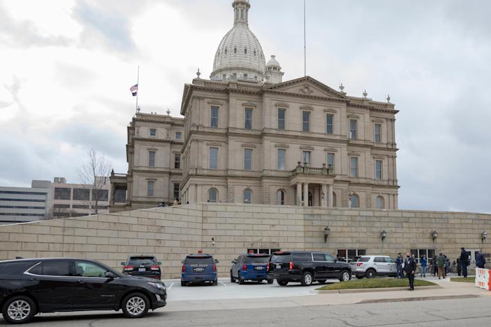 <p>Michigan Governor Gretchen Whitmer was escorted to the state's capitol to preside over the state's Electoral College votes on 14 December.</p> (Getty Images)