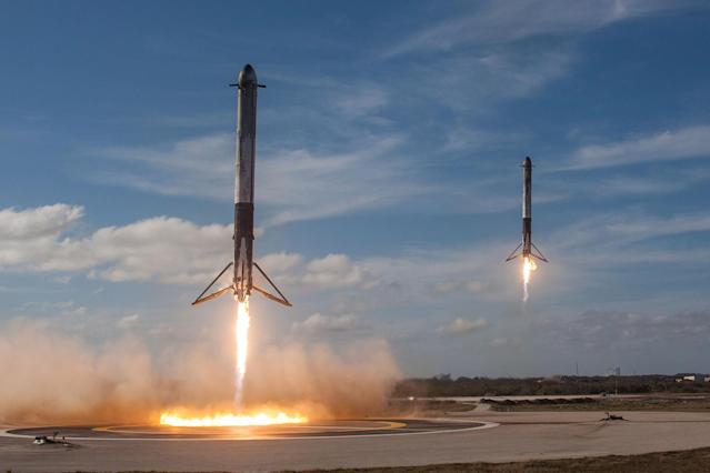 <p>The solid rocket boosters of SpaceX's first Falcon Heavy rocket come back for landing at the Kennedy Space Center in Fla., Feb. 6, 2018. (Photo: SpaceX/Handout via Reuters) </p>