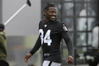 FILE - In this Aug. 20, 2019 file photo, Oakland Raiders' Antonio Brown smiles before stretching during NFL football practice in Alameda, Calif. Brown was released by the Raiders, Saturday, Sept. 7, 2019. (AP Photo/Jeff Chiu, File)