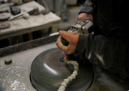Factory worker Danny Bodie smoothes a curling stone in Kays Factory in Mauchline, Scotland, Britain, January 11, 2018. REUTERS/Russell Cheyne