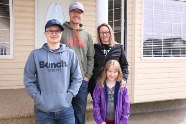 From left to right, Caedon, Shawn, Andrea and Aubrey Bergen. Andrea Bergen says it took months for her family to find the right home. (Jamie Malbeuf/CBC - image credit)